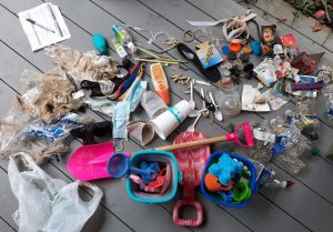Local surf inspired businesses lead a Surfrider Beach Cleanup at Herring Point.